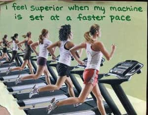 workout meme that says I feel superior when my machine is set at a faster pace. Has several women running on tread mills.