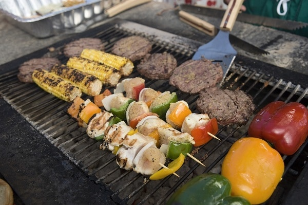 vegetables and meat being grilled