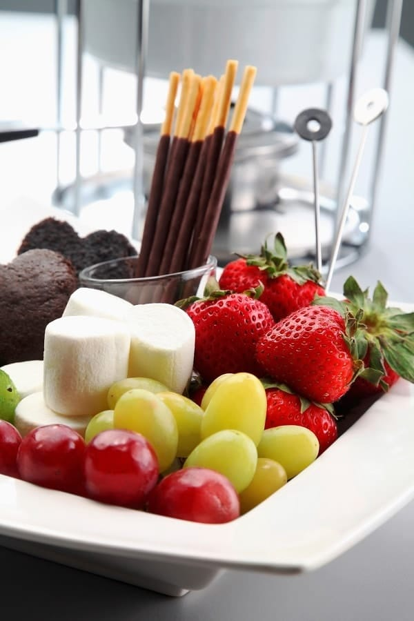 fruit, marshmallows, and brownies for a fondue party