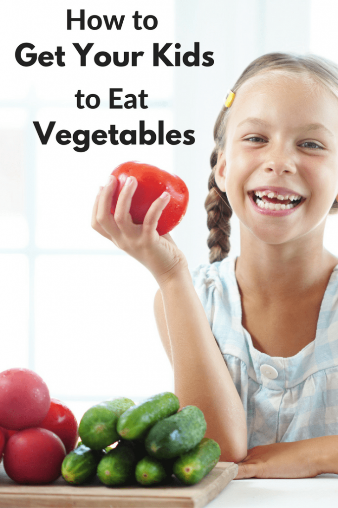 a girl holding a tomato with more vegetables next to her on a wooden cutting board on a white table with title text reading How to Get Your Kids to Eat Vegetables