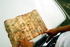 treasure map on hood of car