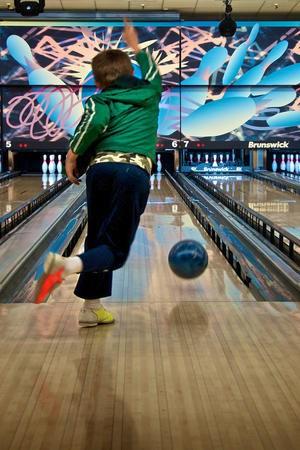 a child bowling