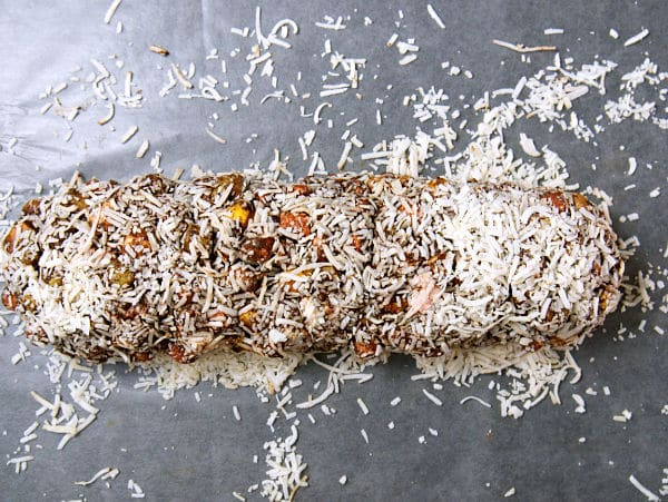 marshmallow chocolate mixture on shredded coconut on waxed paper, topped with more shredded coconut