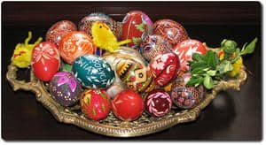 colorful Easter eggs on golden plate