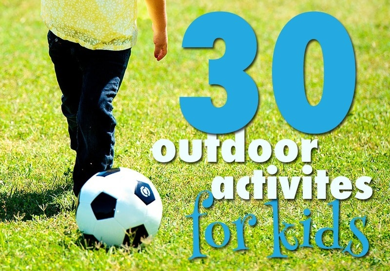 a girl kicking a soccer ball in the grass with title text reading 30 outdoor activities for kids