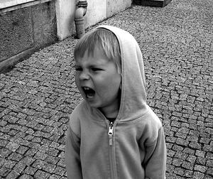 child yelling black and white photo