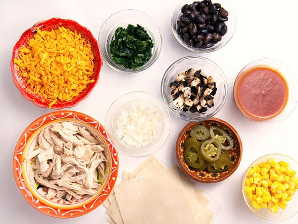 ingredients in bowls for chicken enchilada cups