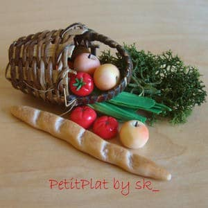 basket of tomatoes, apples, and loaf of bread