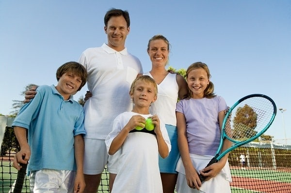 a family ready to play tennis