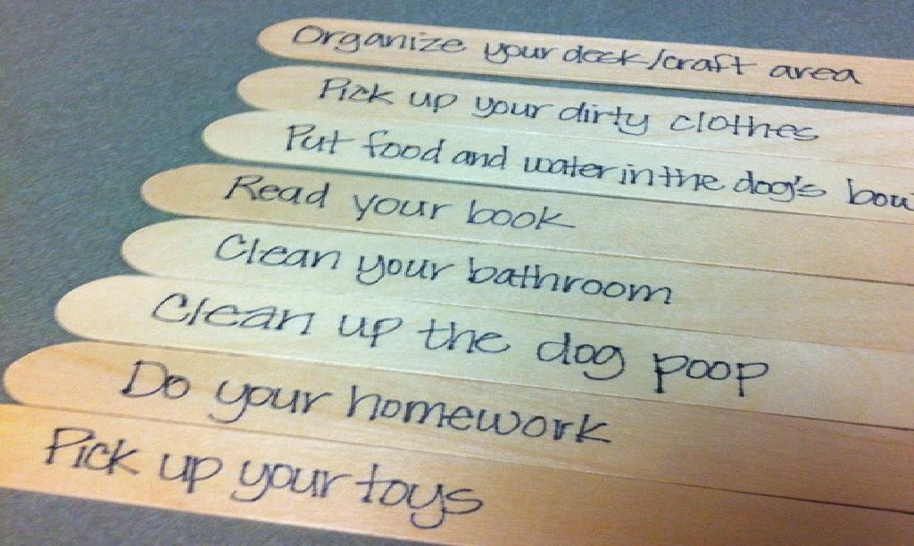 "Trying out a chore stick system in our house for the kid. The men folk in my house need a ""list"" to see that things need to be done around here."