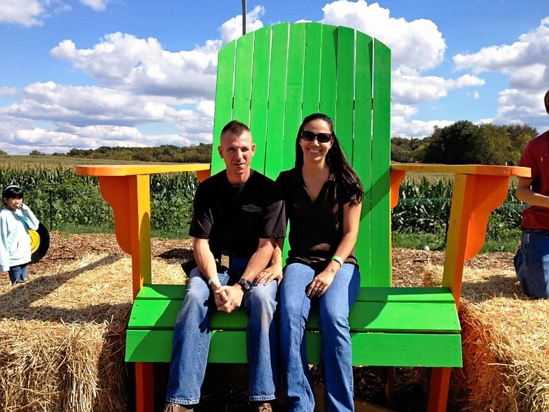 Couples sitting on giant lawn chair