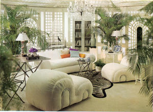 Bright living room with white furniture and lots of greenery