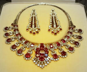 Fancy silver and ruby necklace with matching earrings
