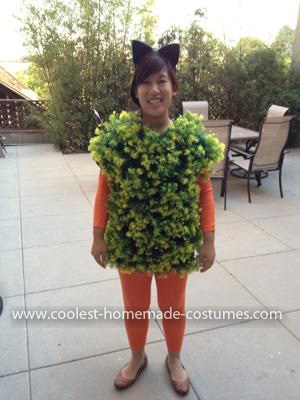 a lady wearing a Chia Pet Costume