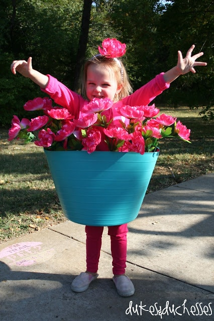 a girl wearing a Flower Pot Costume
