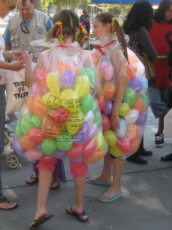 two children dressed in a Jellybean Costume made out of balloons