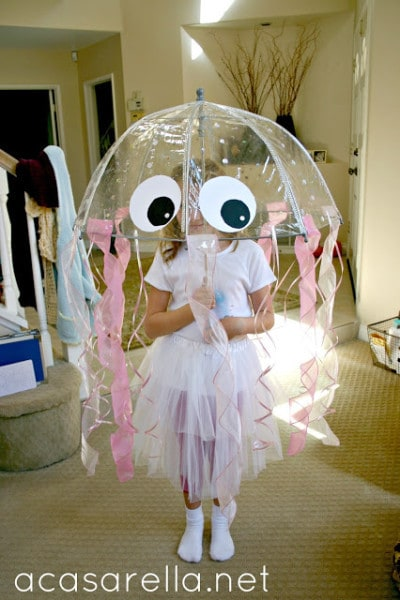a girl in a Jellyfish Costume made out of an umbrella and streamers