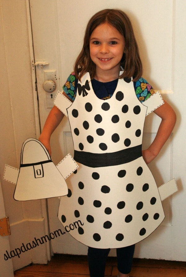 a girl wearing a black and white Paper Doll Costume