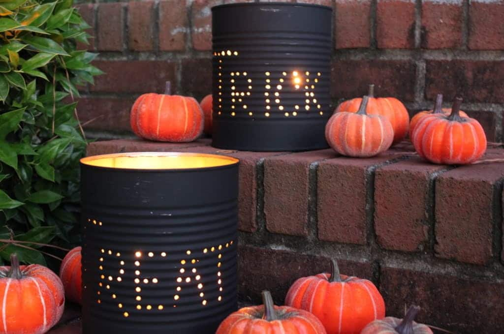 Tin Can Luminaries with the word trick on one and treat on the other