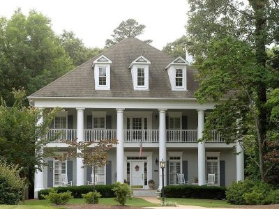 Large grey house with white pillars