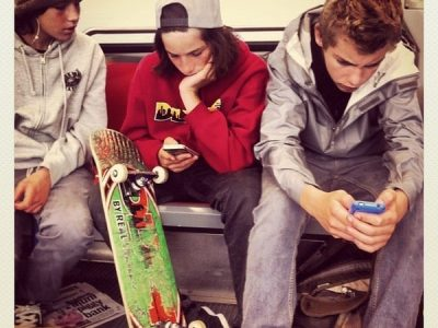 3 teen boys on phones