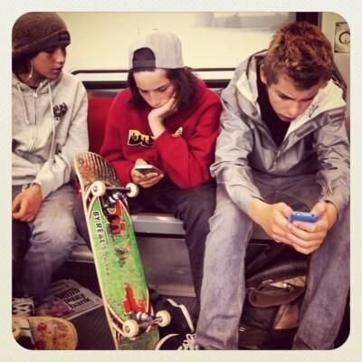 3 teen boys on phones
