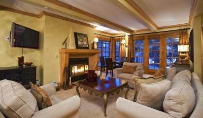 Living room with fire place lit