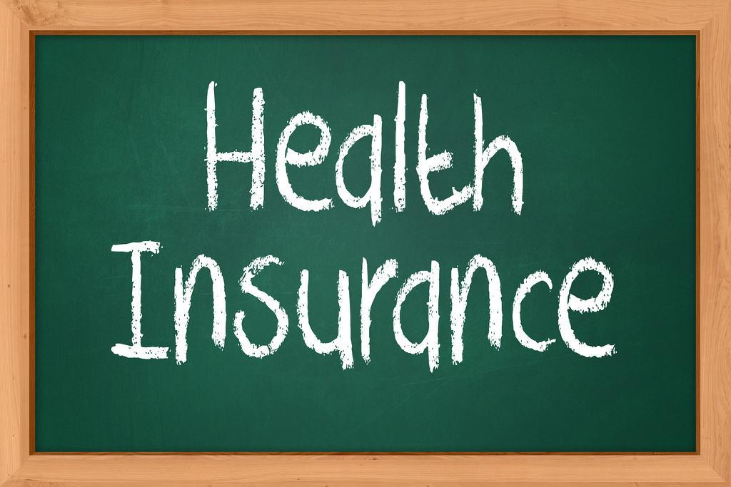 Health insurance written on chalk board