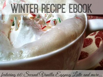 Picture of vanilla eggnog latter with whipped cream and crushed candy cane in white mug