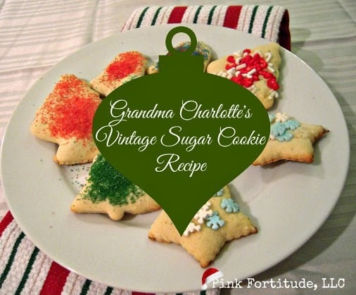 decorated sugar cookies on a white plate with title text reading Grandma Charlotte's Vintage Sugar Cookie Recipe
