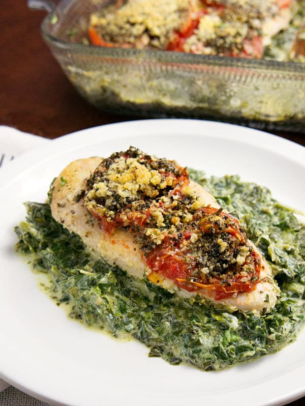 This Chicken Florentine Bake is an easy and flavorful dinner. I cut the fat and calories so this version is equally tasty but healthier. #chicken #chickenflorentinebake #bakedchicken #dinner via @wondermomwannab
