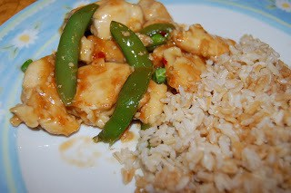 Healthy General Tso Chicken next to rice on a flowered plate