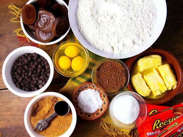 overhead view of ingredients in bowls needed to make Peanut Butter Cup Chocolate Cookies