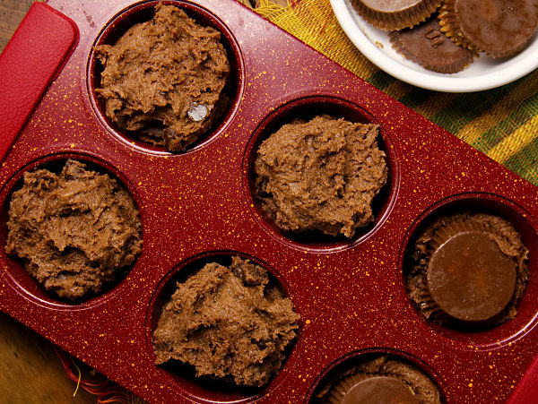 cookie dough in a red muffin tin