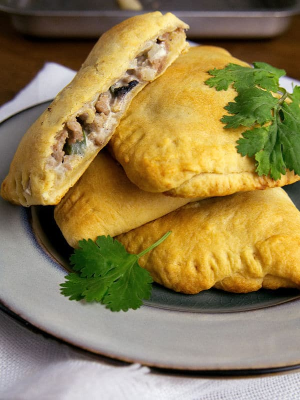 turkey turnovers stacked on a plate