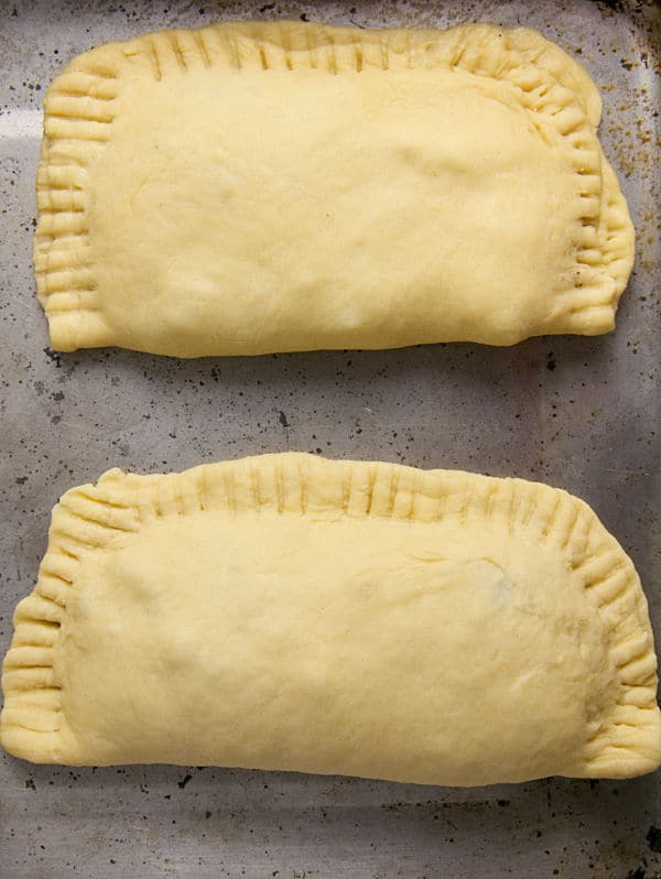 ground turkey turnovers on a baking sheet
