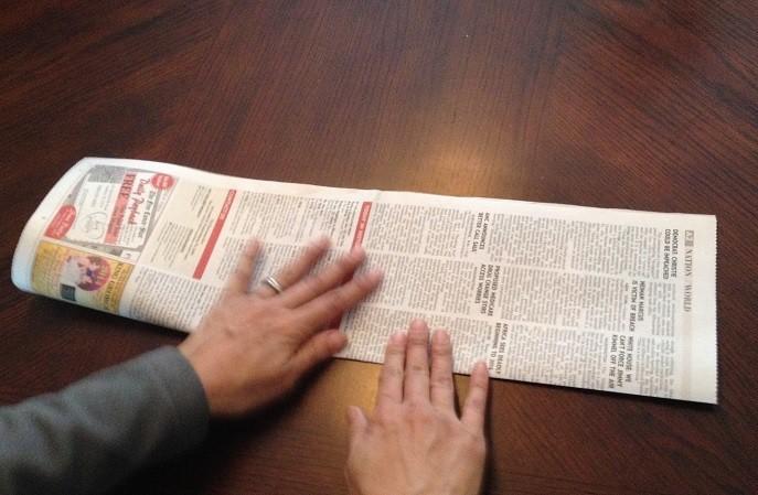 Fold Newspaper in Half