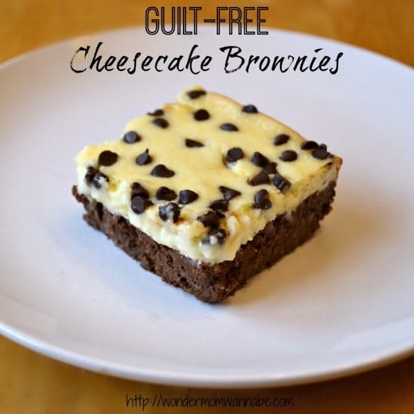 a Cheesecake Brownie on a white plate on a brown table with title text reading Guilt-Free Cheesecake Brownies