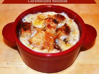 Bread pudding with caramelized bananas in red bowl
