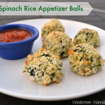 Spinach rice appetizer balls on white plate