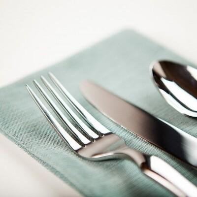 Fork, knife, spoon on napkin