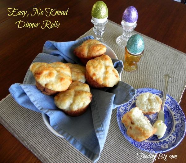 rolls on a plate and in a dish with a cloth in it on a gray mat on a brown table with title text reading Easy, No Knead Dinner Rolls