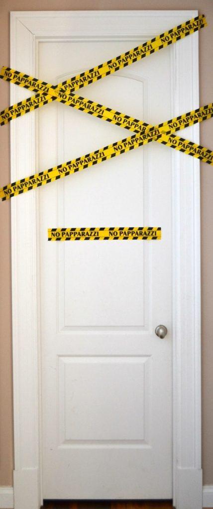 No Papparazzi caution tape on a bathroom door