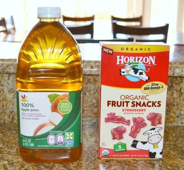 apple juice and fruit snacks on a kitchen counter