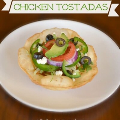 Chicken tostada on white plate