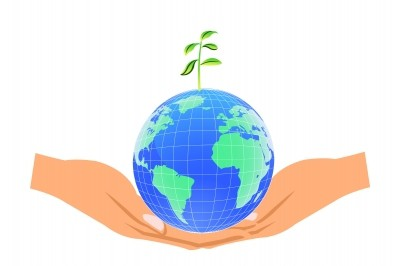 2 hands holding Earth with a plant growing from the top