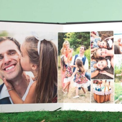 Photo book opened to page with family pictures
