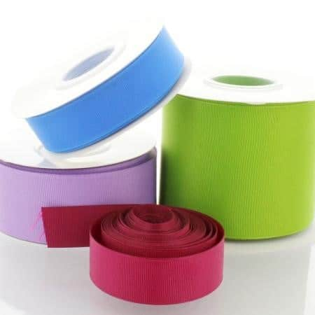 four spools of different colored grossgrain ribbon
