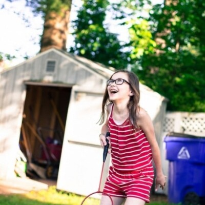 Little girl playing badminton