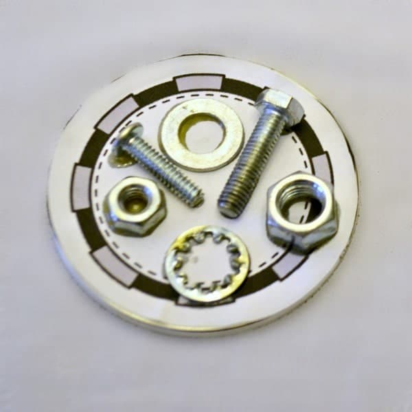 nuts and bolts glued on paper on a mason jar lid
